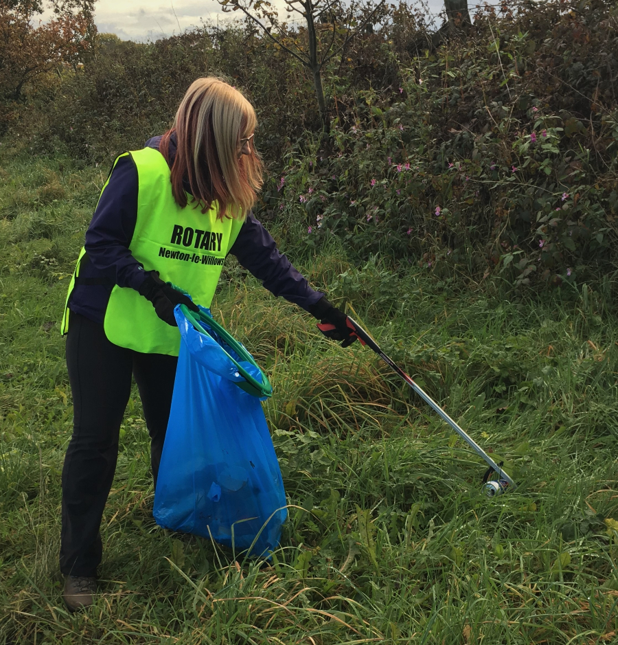 Rotary Newton-le-Willows volunteers carrying out a litter pick in Lowton
