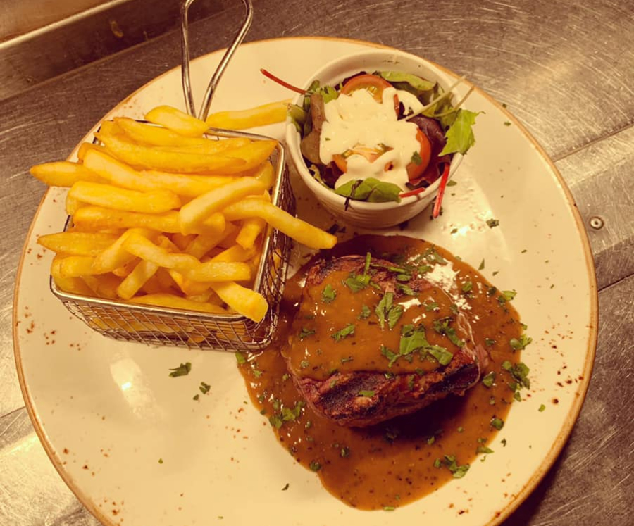 Steak and chips on a plate