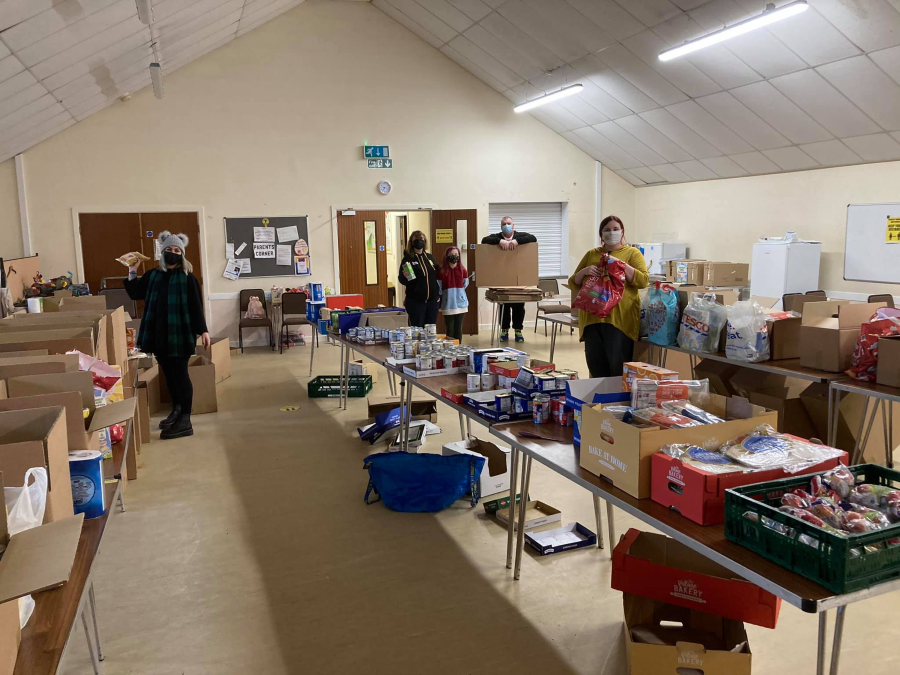 Volunteers from Business for Youth in Newton-le-Willows packing up food parcels for those in need.