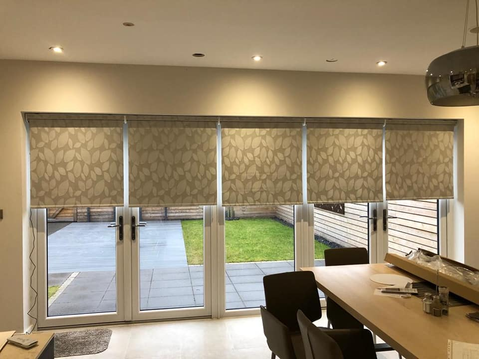 Stylish roller blinds in a contemporary dining room