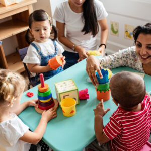 Pre-school children enjoying playing at a nursery or playgroup