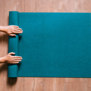 Yoga mat being unrolled for an exercise class